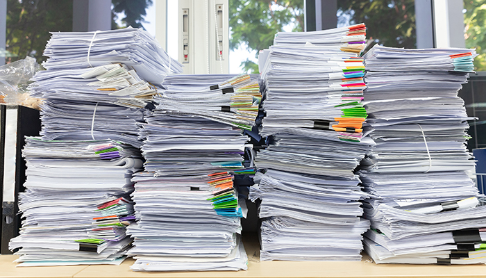 paper stacked on desk
